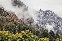 Storm clouds drift through the San Juan Mountains during an autumn storm.  Near Ouray, Colorado.