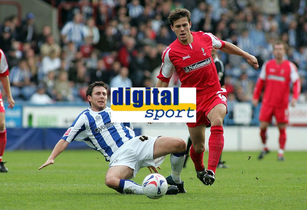 Photo: Paul Thomas.<br /> Huddersfield Town v Swindon Town. Coca Cola League 1. 29/10/2005. <br /> <br /> Swindon's Stefani Miglioranzi beats of a tackle from Mark Hudson.