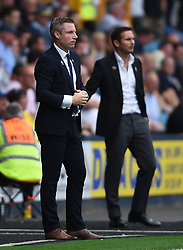 Millwall manager Neil Harris and Derby County manager Frank Lampard on the touchline