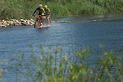 Luc Bellings and Danny Simons cross the Breede river during stage 2 of the 2014 Absa Cape Epic Mountain Bike stage race from Arabella Wines in Robertson, South Africa on the 25 March 2014<br /> <br /> Photo by Greg Beadle/Cape Epic/SPORTZPICS