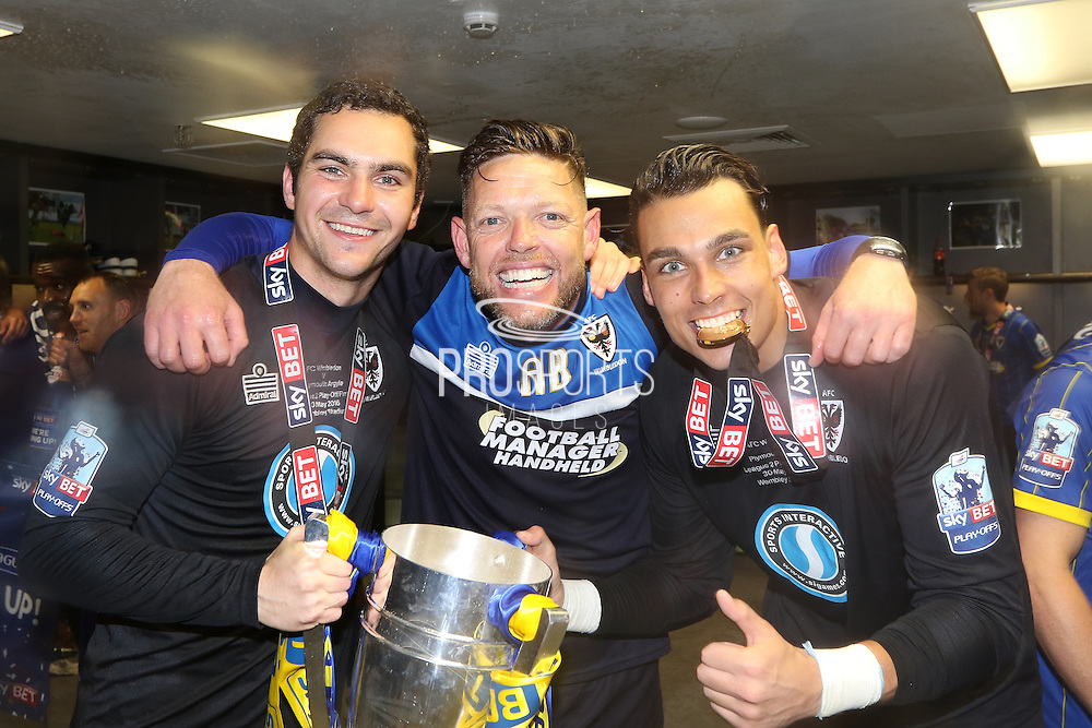 Ashley Bayes, AFC Wimbledon goalkeeper James Shea (1) and AFC Wimbledon goalkeeper Kelle Roos (29) celebrating in the dressing room at Wembley after winning the Sky Bet League 2 play off final match between AFC Wimbledon and Plymouth Argyle at Wembley Stadium, London, England on 30 May 2016.