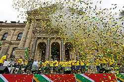 Monday 11th November 2019.<br /> City Hall, Grand Parade,<br /> And City Centre, Cape Town,<br /> Western Cape,<br /> South Africa.<br /> <br /> SPRINGBOKS CELEBRATE WINNING THE RUGBY WORLD CUP CHAMPIONSHIP IN 2019 WITH A COUNTRYWIDE VICTORY TOUR!<br /> <br /> SPRINGBOKS RUGBY WORLD CUP VICTORY TOUR CAPE TOWN!<br /> <br /> The Springboks take the stage outside the City Hall as they are cheered on by thousands of excited fans. South African Captain Siya Kolisi and his team mates enjoy the festivities prepared for them as they are showered with yellow and green plastic confetti outside the Cape Town City Hall.<br /> <br /> The reigning Rugby World Cup Champions namely the South African Springbok Rugby Team, celebrates winning the Webb Ellis Cup during the International Rugby Football Board Rugby World Cup Championship held in Japan in 2019 with their Victory Tour that culminated in the final city tour taking place in Cape Town. Thousands of South African fans filled the streets of the city all trying their best to show their support for their beloved Springboks and to celebrate them winning the Rugby World Cup for the third time. South Africa previously won the Rugby World Cup in 1995, 2007 and now again in 2019. South African Springbok Captan Siya Kolisi took the opportunity to speak to the gathered crowd about how something like this brings unity and that we should live together as a nation that practices what is known as ubuntu. Ubuntu is a quality that includes the essential human virtues of compassion and humanity. This image taken in Cape Town on Monday 11th November 2019.<br /> <br /> This image is the property of Seven Bang Media Group (Pty) Ltd, hereinafter referred to as SBM.<br /> <br /> Picture By: SBM / Mark Wessels. (11/11/2019).<br /> +27 (0)61 547 2729<br /> mark@sevenbang.com<br /> www.sevnbang.com<br /> <br /> Copyright © SBM. All Rights Reserved.