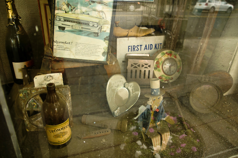 Old dusty collectibles in a store window in Red Hook, brooklyn