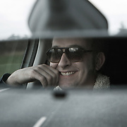 Søren Hamborg behind the wheel on his way to work. Cafe Kølbert is a groupof show waiters who entertain at parties with their slap-stick and sometime crude jokes. The company has been running for more than 25 years and Søren Hamborg is one of the founding members of Cafe Kølbert.