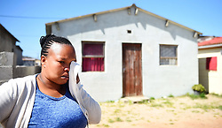 South Africa -Cape Town - 21  September 2020- Nonceba Dyantyi in tears infront of a house where her naphew Lungile Xelelo and other four men were shot and killed in Noxolo street Crossroads.The man has been discribed by his family as a church goer and lead singer,he had just arrived at home when he went for a soft drink with men who were sitting at neighbours house.There has not been any arrest since the shooting took place.The family also said this is the second similar incident to happen on their street,the first one was on Heritage day in 2018 ans there was no arrest for that as well .Picture:Phando Jikelo/African News Agency(ANA)