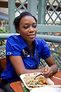 Tiffany Whitehead, a student and part-time ride supervisor at the Mall of America amusement park, having lunch at the mall in Bloomington, Minnesota. (Featured in the book What I Eat: Around the World in 80 Diets.) MODEL RELEASED.