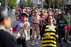 Runners, walkers, the costumed and those wearing nothing at all traverse the 7.46-mile course from San Francisco Bay to the Pacific Ocean at the 107th running of the Bay to Breakers, Sunday, May 20, 2018, in San Francisco. (Photo by D. Ross Cameron)