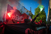 """01/05/2015 – Berlin, Germany: Members of Anarchist groups light torches during the """"Revolutionary 1st of May Demonstrations"""" in Kreuzberg to mark the Workers Day. The International Workers Day is a celebration of laborers and the working classes that is promoted by the international labor movement, anarchists, socialists, and communists and occurs every year on May Day. (Eduardo Leal)"""