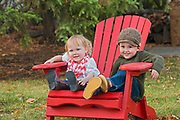 Young  boy and girl playing in backyard<br />Winnipeg<br />Manitoba<br />Canada