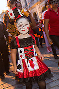 A young girl dressed as a skeleton during the Day of the Dead Festival known in spanish as Día de Muertos October 30, 2014 in Oaxaca, Mexico.
