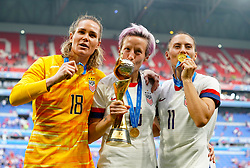 (left to right) USA's Ashlyn Harris, Megan Rapinoe and Ali Krieger celebrate with the trophy after winning the FIFA Women's World Cup 2019