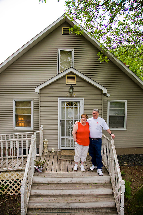 John McQuiston, a head lock and dam number 1 operator at his home with his wife in Minneapolis, Minnesota. MODEL RELEASED.