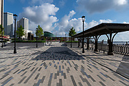 New Orleans, LA, USA -- May 25, 2019. A wide angle photo of an empty public plaza by the Mississippi River on a Saturday morning.