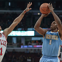 08 November 2010: Denver Nuggets' point guard #1 Chauncey Billups takes a jumpshot over Chicago Bulls' point guard #1 Derrick Rose during the Chicago Bulls 94-92 victory over the Denver Nuggets at the United Center, in Chicago, Illinois, USA.