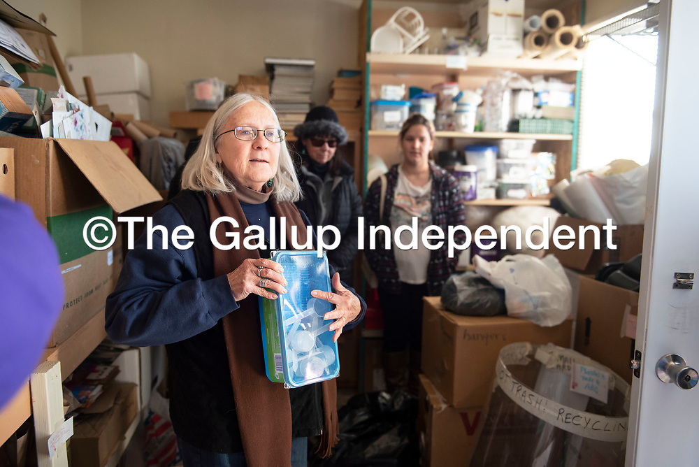 Betsy Windisch, chair of McKinley Citizens' Recycling Council holds up a collection of plastic scoops as an example of the reusable materials they collect in the recycling depot trailer at the Gallup Recycling Center Saturday, Jan. 4 in Gallup.