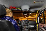 Guide Brynjar Augusston drive tour bus through the Hvalfjörður Tunnel in Iceland