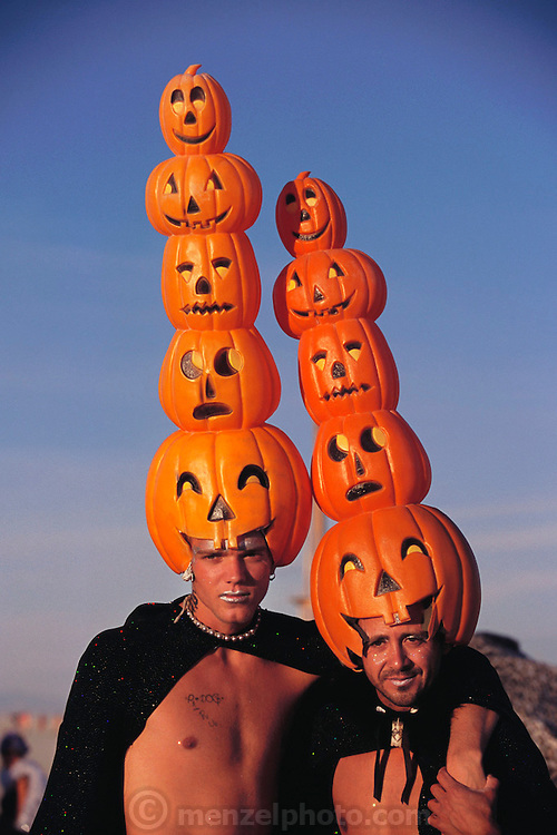 Festival participants: two men with pumpkin hats at Burning Man. Burning Man is a performance art festival known for art, drugs and sex. It takes place annually in the Black Rock Desert near Gerlach, Nevada, USA.