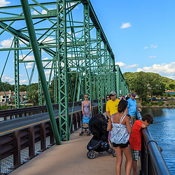 The New Hope – Lambertville Bridge crosses the Delaware River and is used by tourists and visitors, in addition to vehicle traffic.