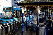 An Arriva bus leaves the bus stop outside Conwy town centre station, on 4th October 2021, in Conwy, Gwynedd, Wales.