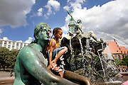 BERLIN, GERMANY - 26/06/2008 - TRAVEL, Children refreshing in the fountain of the Schlobplace on a hot day..cfr. Berlin, Germany, capital, hot, heat, cooling, warm, summer, ..©Christophe VANDER EECKEN