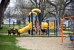 COVID-19 Novel coronavirus forces playground equipment to be wrapped in caution tape and placed off limits.