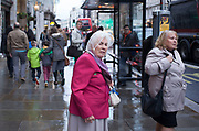 Elderly woman out and about on The Strand in London, UK.