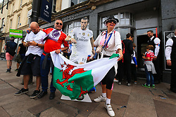 3 June 2017 - UEFA Champions League Final - Juventus v Real Madrid - Fans pose with a cut-out of Gareth Bale outside his bar 'Elevens' - Photo: Marc Atkins / Offside.