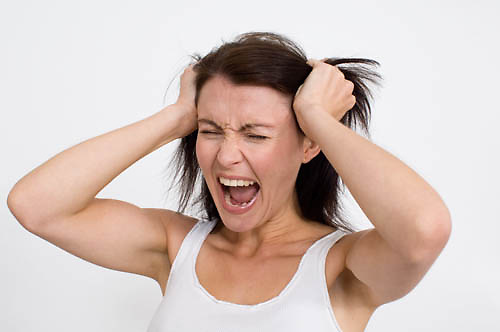 women pulling her hair out in frustration<br />