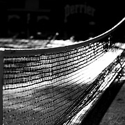 2017 French Open Tennis Tournament - The tennis net stands out against the watered outside clay court at the end of the day in preparation for the 2017 French Open Tennis Tournament at Roland Garros on May 26th, 2017 in Paris, France.  (Photo by Tim Clayton/Corbis via Getty Images)
