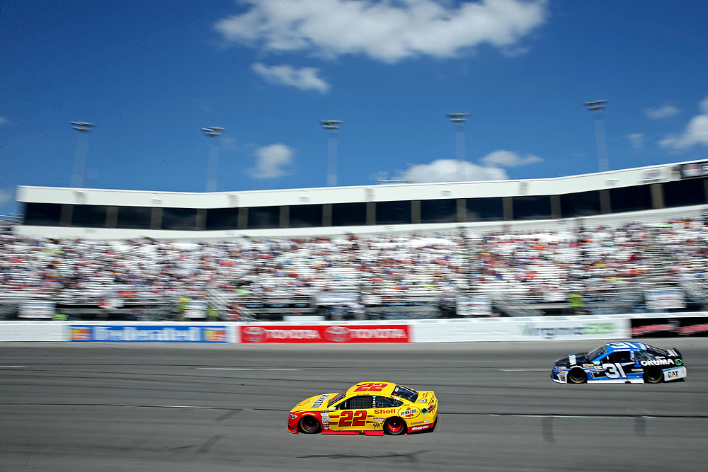 Apr 30, 2017; Richmond, VA, USA; NASCAR Cup Series driver Joey Logano (22) and NASCAR Cup Series driver Ryan Newman (31) during the Toyota Owners 400 at Richmond International Raceway. Mandatory Credit: Peter Casey-USA TODAY Sports