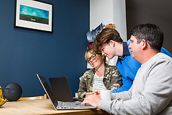 Mum Nancy, 43 and Dad Chris, 44, pictured with eldest son Stevie, 15, are able to manage their whole family's online demands thanks to BT Wifi. Real-life case study campaign, showcasing BT's complete Wi-Fi offering. London, May 16 2019.