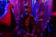 Men socialise in a local bar in the slum of Majengo in Nairobi.