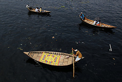 March 22, 2019 - Dhaka, Bangladesh - People cross polluted Buringanga River by boats in Dhaka, Bangladesh on March 22, 2019. Buringanga is one of the most polluted river in the country due to extensive dumping of industrial and human waste. (Credit Image: © Rehman Asad/NurPhoto via ZUMA Press)