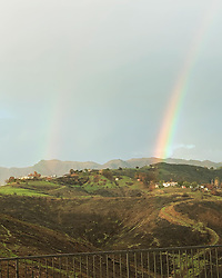 """Caitlyn Jenner releases a photo on Instagram with the following caption: """"Double rainbow over the burn area \ud83c\udf08 \ud83c\udf08"""". Photo Credit: Instagram *** No USA Distribution *** For Editorial Use Only *** Not to be Published in Books or Photo Books ***  Please note: Fees charged by the agency are for the agency's services only, and do not, nor are they intended to, convey to the user any ownership of Copyright or License in the material. The agency does not claim any ownership including but not limited to Copyright or License in the attached material. By publishing this material you expressly agree to indemnify and to hold the agency and its directors, shareholders and employees harmless from any loss, claims, damages, demands, expenses (including legal fees), or any causes of action or allegation against the agency arising out of or connected in any way with publication of the material."""