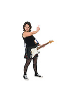 Female guitarist with rude hand sign