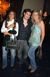 Left to right, SARA LAW, ZAFAR RUSHDIE and HELEN FARR at a Lonsdale Supper Club party held at the Cafe de Paris, Coventry Street, London on 28th September 2006.<br />