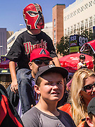 16 SEPTEMBER 2012 - PHOENIX, AZ:  An Arizona Diamondbacks fan arrives at the Diamondbacks' game in a Lucha Libre mask for Hispanic Heritage Day. The Arizona Diamondbacks hosted their 14th Annual Hispanic Heritage Day, Sunday to kick off Hispanic Heritage Month (Sept. 15-Oct. 15) before the 1:10 p.m. game between the D-backs and San Francisco Giants. The main attraction of the Day was three Lucha Libre USA exhibition wrestling matches in front of Chase Field stadium before the game.   PHOTO BY JACK KURTZ