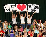 Loughborough, England - Saturday 31 July 2010: Belgian supporters cheer their team during the World Rope Skipping Championships held at Loughborough University, England. The championships run over 7 days and comprise junior categories for 12-14 year olds in the World Youth Tournament, 15-17 year olds male and female championships, and any age open championships. In the team competitions, 6 events are judged, the Single Rope Speed, Double Dutch Speed Relay, Single Rope Pair Freestyle, Single Rope Team Freestyle, Double Dutch Single Freestyle and Double Dutch Pair Freestyle. For more information check www.rs2010.org. Picture by Andrew Tobin/Picture It Now.