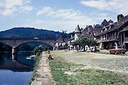 Man fishing in Dordogne river, Quai Lestourgie, Argentat-sur-Dordogne,  France1971