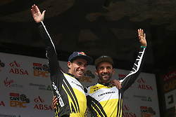 Overall Race Leaders Henrique Avancini and Manuel Fumic of Cannondale Factory Racing XC celebrate on the podium during stage 1 of the 2017 Absa Cape Epic Mountain Bike stage race held from Hermanus High School in Hermanus, South Africa on the 20th March 2017<br /> <br /> Photo by Shaun Roy/Cape Epic/SPORTZPICS<br /> <br /> PLEASE ENSURE THE APPROPRIATE CREDIT IS GIVEN TO THE PHOTOGRAPHER AND SPORTZPICS ALONG WITH THE ABSA CAPE EPIC<br /> <br /> {ace2016}
