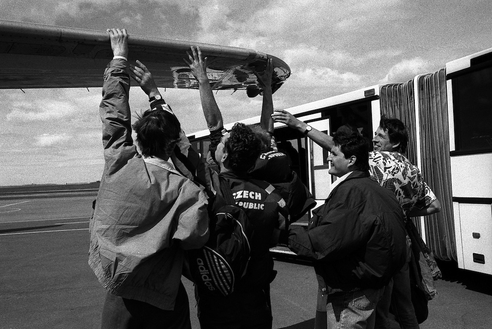 Members of the Czech team are touching the wings of the plane they flew with, to get an imagination of the plane size.