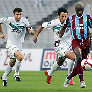 Trabzonspor's Ibrahima YATTARA (F) and Denizlispor's Ahmet B SOLAKEL (C) during their Turkish superleague soccer match Trabzonspor between Denizlispor at the Avni Aker Stadium in Trabzon Turkey on Monday, 10 May 2010. Photo by TURKPIX