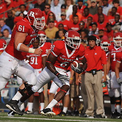 Sep 7, 2009; Piscataway, NJ, USA; Rutgers wide receiver Mohamed Sanu (6) runs after a catch with blocking help from center Ryan Blaszczyk (61) during the first half of Rutgers' game against Cincinnati in NCAA college football at Rutgers Stadium.