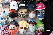 Goulish face masks of World leaders wearing face masks themselves due to the Coronavirus pandemic for sale on 13th August 2020 in London, United Kingdom.