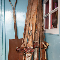 Vintage skis and a shovel stand outside a hut at Port Lockroy, an abandoned British Science base on Goudier Island, Antarctica that has been restored as a museum.