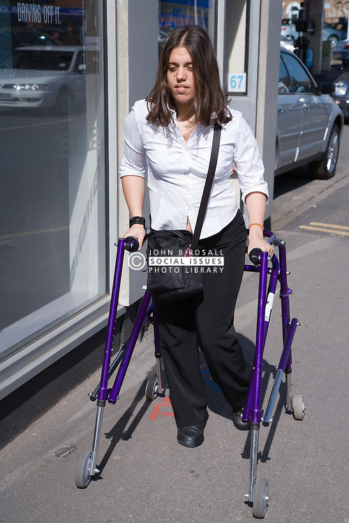 Young woman with walking frame going to work,