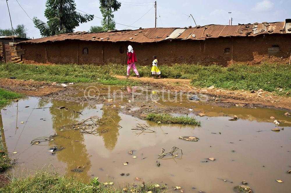 A street scene in the Kiandutu slum. Open sewers are a regular scene in the biggest slum in Thika, Kenya.