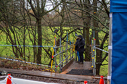 © Licensed to London News Pictures. 12/12/2019. Gerrards Cross, UK. Police officers stand on a specially constructed stairway at the site of a search operation as the Metropolitan Police Service confirm they are searching woodland in Beaconsfield, Buckinghamshire in connection with the disappearance and murder of Mohammed 'Shah' Subhani. Police have been in the area conducting operations on Hedgerley Lane since Thursday 5th December 2019 and are combing wooded area with specialist officers, assisted by specialist search dogs. Photo credit: Peter Manning/LNP