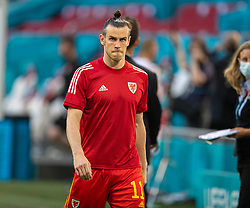 AMSTERDAM, THE NETHERLANDS - Saturday, June 26, 2021: A dejected Wales captain Gareth Bale walks to do his media interviews after the UEFA Euro 2020 Round of 16 match between Wales and Denmark at the Amsterdam Arena. Denmark won 4-0. (Photo by David Rawcliffe/Propaganda)