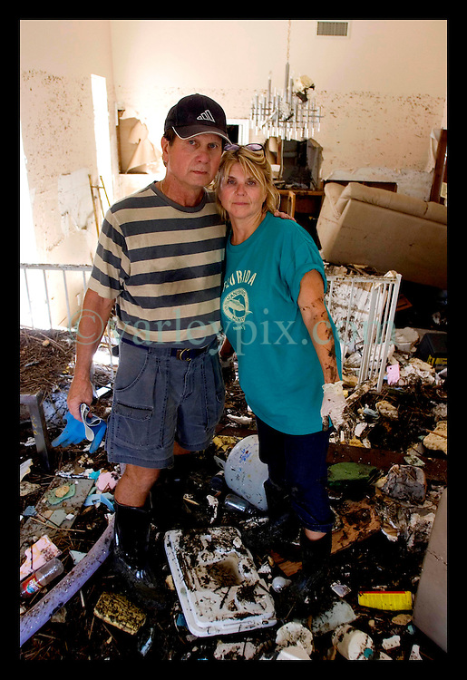 8th Sept, 2005. Hurricane Katrina aftermath. New Orleans. Venetian Isles in East New Orleans, where the tidal surge washed over the land and devastated homes and property. John and Peggy Lala survey the damage of their mud fiolled flood ravaged home.
